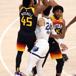 Utah Jazz guard Donovan Mitchell (45) is fouled by Memphis Grizzlies forward Dillon Brooks (24) behind the 3-point line as the Utah Jazz and Memphis Grizzlies play Game 2 of their NBA playoffs first round series at Vivint Arena in Salt Lake City on Wednesday, May 26, 2021.