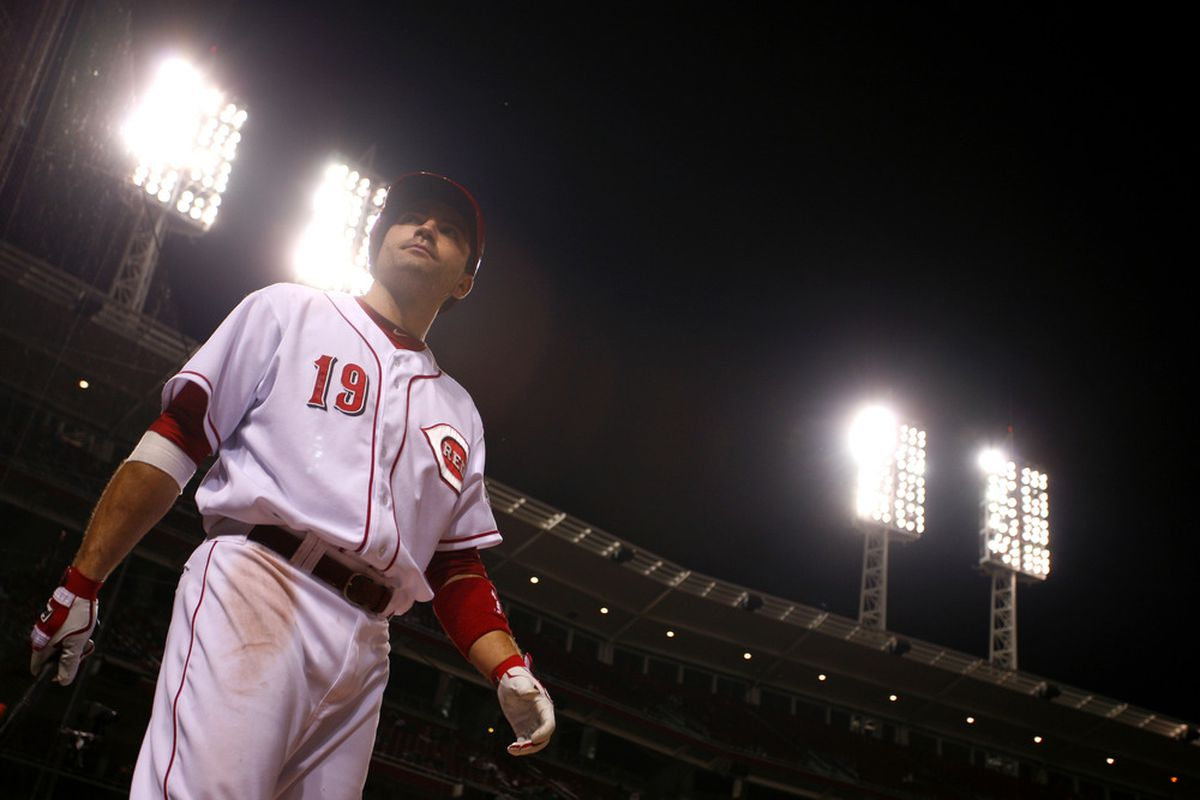 CINCINNATI, OH - JUNE 5:   Joey Votto #19 of the Cincinnati Reds looks on before batting against the Pittsburgh Pirates during the game at Great American Ball Park on June 5, 2012 in Cincinnati, Ohio. (Photo by Tyler Barrick/Getty Images)