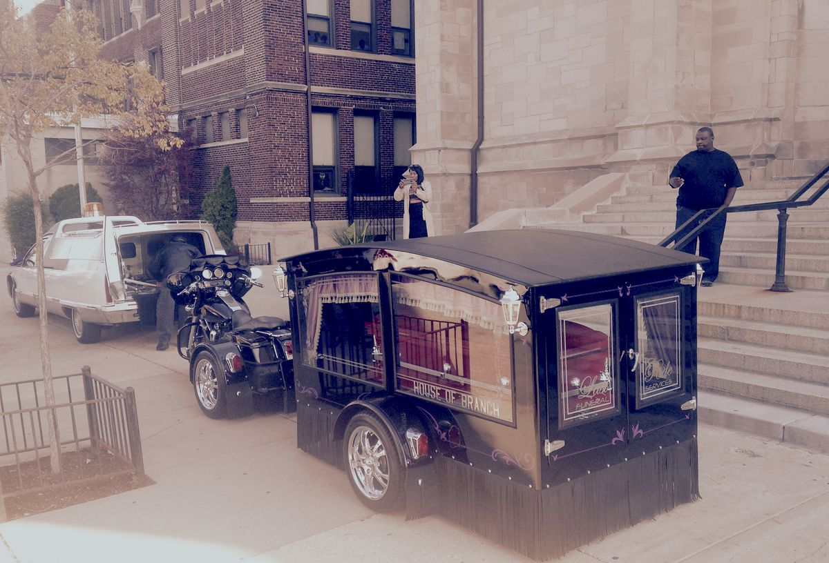 The trailer carrying Tyshawn Lee's casket was towed to St. Sabina Church by a motorcycle. | Mitch Dudek/Sun-Times