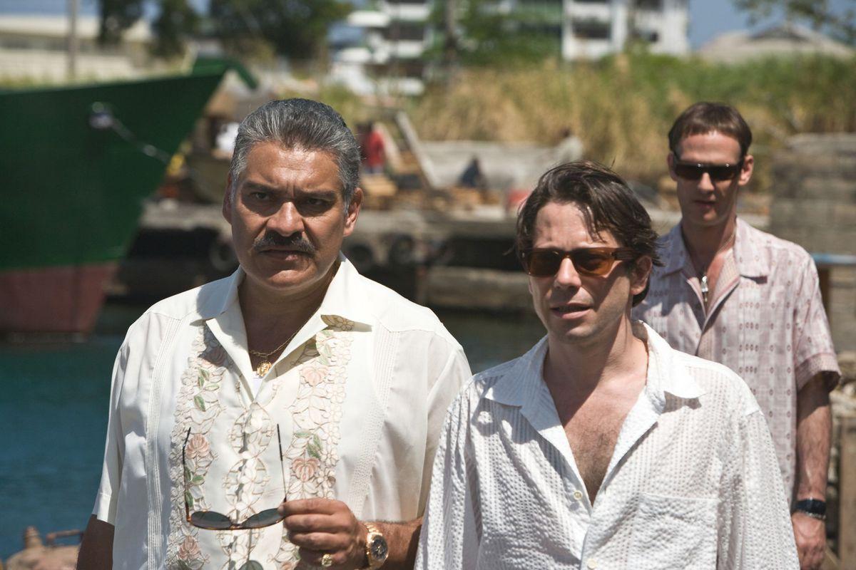 three men walking down a pier