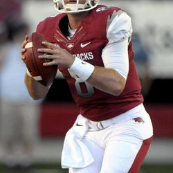 Arkansas quarterback Tyler Wilson looks for a receiver during the first half of an NCAA college football game with Louisiana-Monroe in Little Rock, Ark., Saturday, Sept. 8, 2012.
