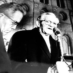 President David O. McKay at the ceremony opening the first lighting of Temple Square, Dec. 18, 1965. Assisting is President N. Eldon Tanner.