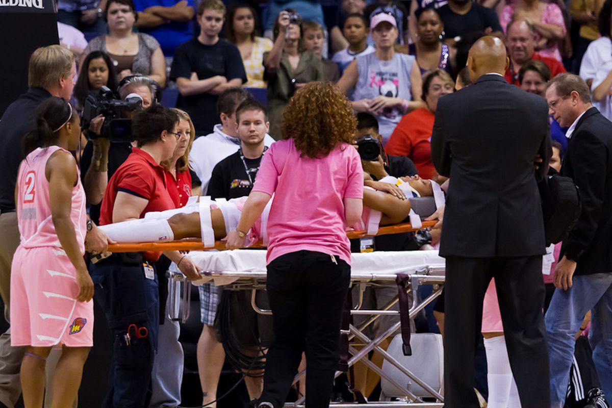 DeWanna Bonner taken off the court on a stretcher. (Photo by Ryan Malone).