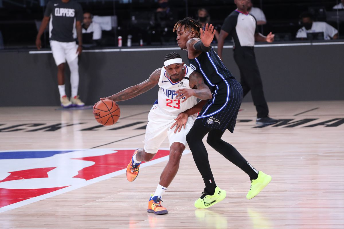 Lou Williams of the LA Clippers drives to the basket against the Orlando Magic on July 22, 2020 at The Arena at ESPN Wide World of Sports Complex in Orlando, Florida.