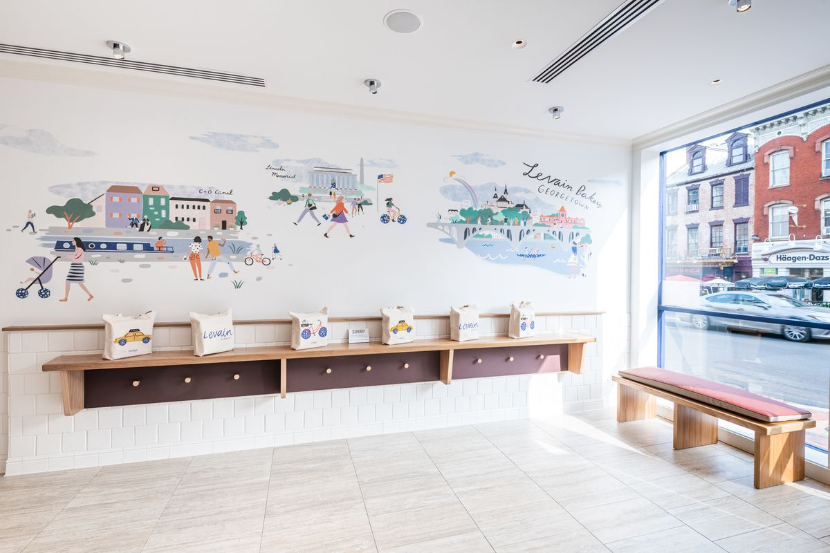 Levain's D.C. bakery features a mural with scenes from its new Georgetown neighborhood.