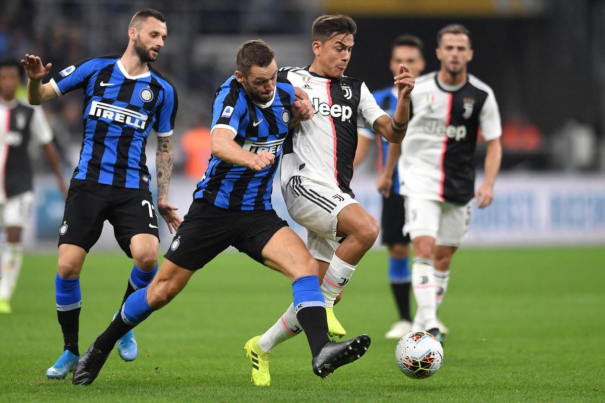 Marcelo Brozovic and Stefan de Vrij of FC Internazionale...