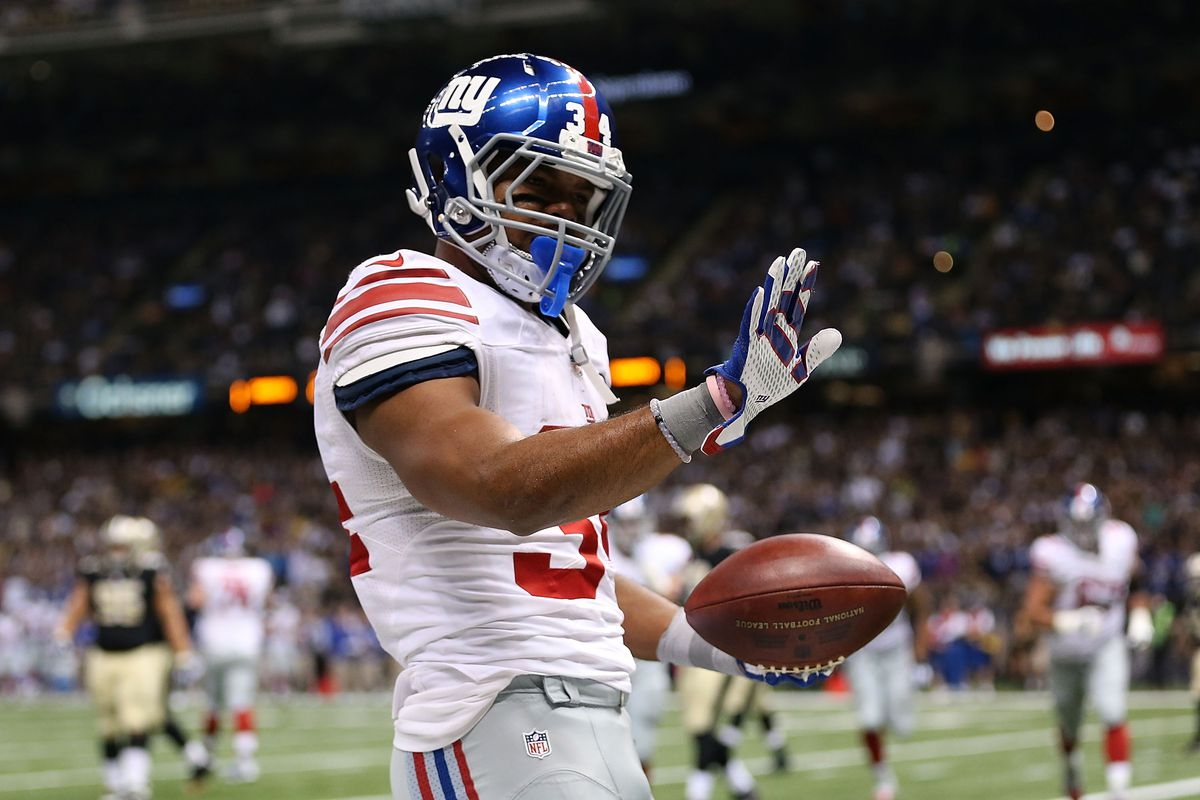 NEW ORLEANS, LA - Shane Vereen #34 of the New York Giants celebrates a touchdown during the second quarter of a game against the New Orleans Saints at the Mercedes-Benz Superdome.