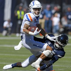 Boise State wide receiver Khalil Shakir (2) spins away from Utah State safety Dusten Ramseyer-Burdett (36) during the second half of an NCAA college football game Saturday, Sept. 25, 2021, in Logan, Utah.