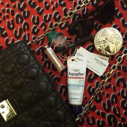 What's in my purse? Not a whole lot—most of my purses are really small. My essentials are <b>Aquaphor</b>, <b>Dior</b> Addict Lip Glow, <b>Nars</b> Velvet Lip Gloss in Mexican Rose, <b>Rohto</b> Cool Eye Drops (a favorite of makeup artist and friend <b>Sh