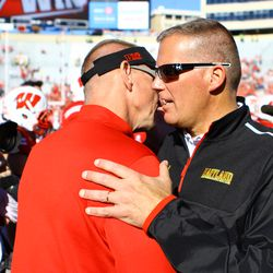 Head Coach Gary Andersen shakes hands with Maryland's coach Randy Edsall
