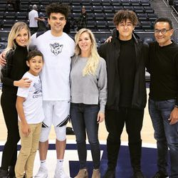 The Bryant family pose after a BYU basketball game, from left, Elijah's wife, Janelle; brother Kai; mom Israel; brother Choe; and dad Reggie.