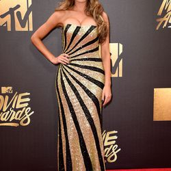 Farrah Abraham wears a shimmering gold and black gown.
