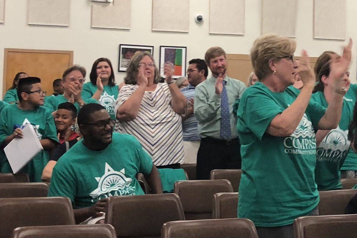 Supporters of New Day Schools, which plans to open six schools in the buildings currently used by Jubilee Catholic Schools Network, applaud the decision of Shelby County Schools board.