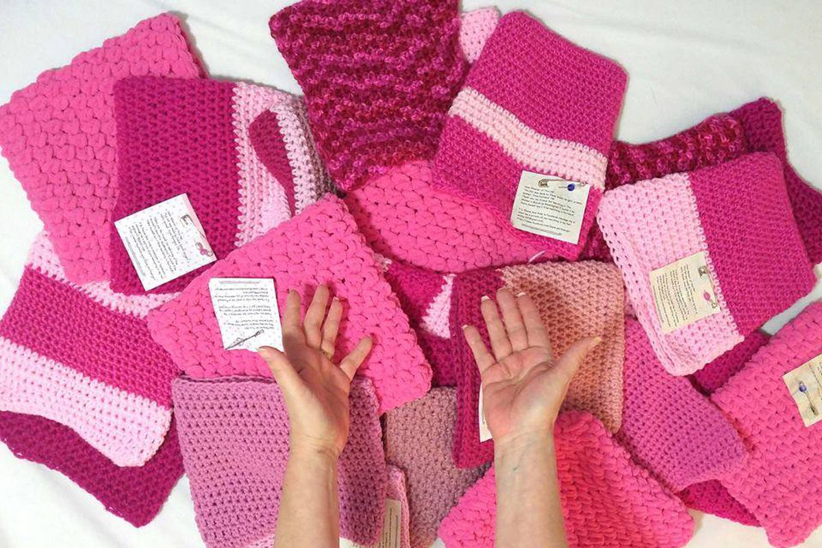 A bunch of pink knit and sewn hat, called pussyhats for the purpose of the march