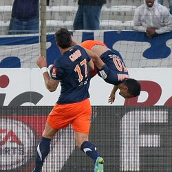 Montpellier's French midfielder Younes Belhanda, behind, reacts with Montpellier's French forward Olivier Giroud, after scoring against Marseille, during their League One soccer match, at the Velodrome stadium, in Marseille, southern France, Wednesday, April 11,  2012.