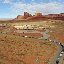 Vehicles line up for COVID-19 testing outside of the Monument Valley Health Center in Oljato-Monument Valley, San Juan County, on Friday, April 17, 2020. More than a thousand people got tested over the course of two days. The Navajo Nation has one of the highest per capita COVID-19 infection rates in the country.