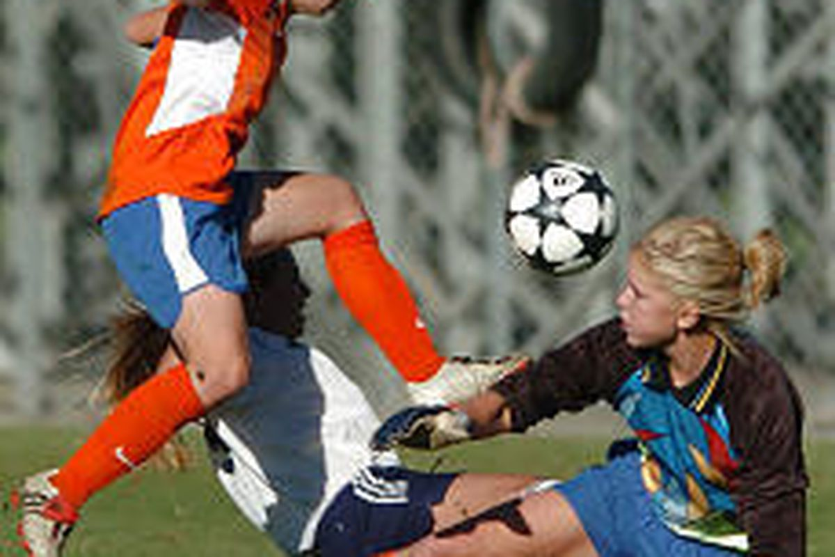 Timpview keeper Lindsey Freeze, right, watches teammate Kellie Woodfield try to clear the ball Thursday.