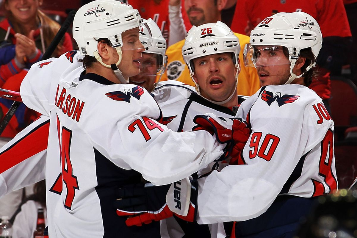 NEWARK, NJ - NOVEMBER 11:  Marcus Johansson #90 (R) of the Washington Capitals  celebrates his goal with teammates against the New Jersey Devils at Prudential Center on November 11, 2011 in Newark, New Jersey.  (Photo by Nick Laham/Getty Images)