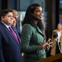 Gov. J.B. Pritzker looks on as Cook County State's Attorney Kim Foxx speaks during a press conference at the Leighton Criminal Courthouse after Foxx filed motions to vacate more than 1,000 low-level cannabis convictions, Wednesday afternoon, Dec. 11, 2019.
