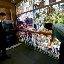 """Utah Valley University President Matthew Holland and Tom Holdman look at the progress of """"Roots of Knowledge"""" at Holdman Studios at Thanksgiving Point in Lehi on Friday, Sept. 16, 2016. A Guardian UK reporter called the work """"one of the most spectacular stained glass windows made in the past century."""""""