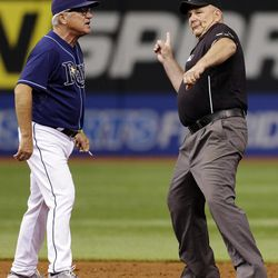 Second base umpire Bob Davidson, right, ejects Tampa Bay Rays manager Joe Maddon as he argues a close play on a stolen base attempt at second base during the eighth inning of a baseball game against the New York Yankees, Monday, Sept. 3, 2012, in St. Petersburg, Fla. The Rays won 4-3.