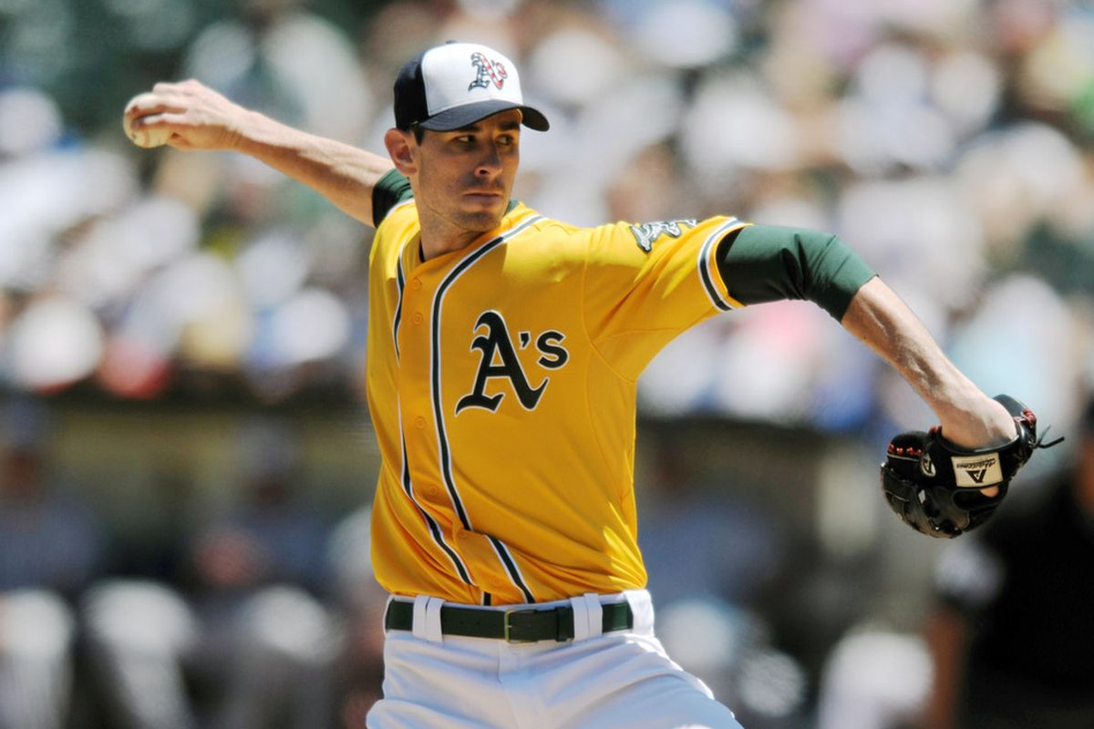 OAKLAND, CA - JULY 4:  Brandon McCarthy #32 of the Oakland Athletics makes his delivery against the Seattle Mariners at Oakland-Alameda County Coliseum on July 4, 2011 in Oakland, California. (Photo by Chad Ziemendorf/Getty Images)