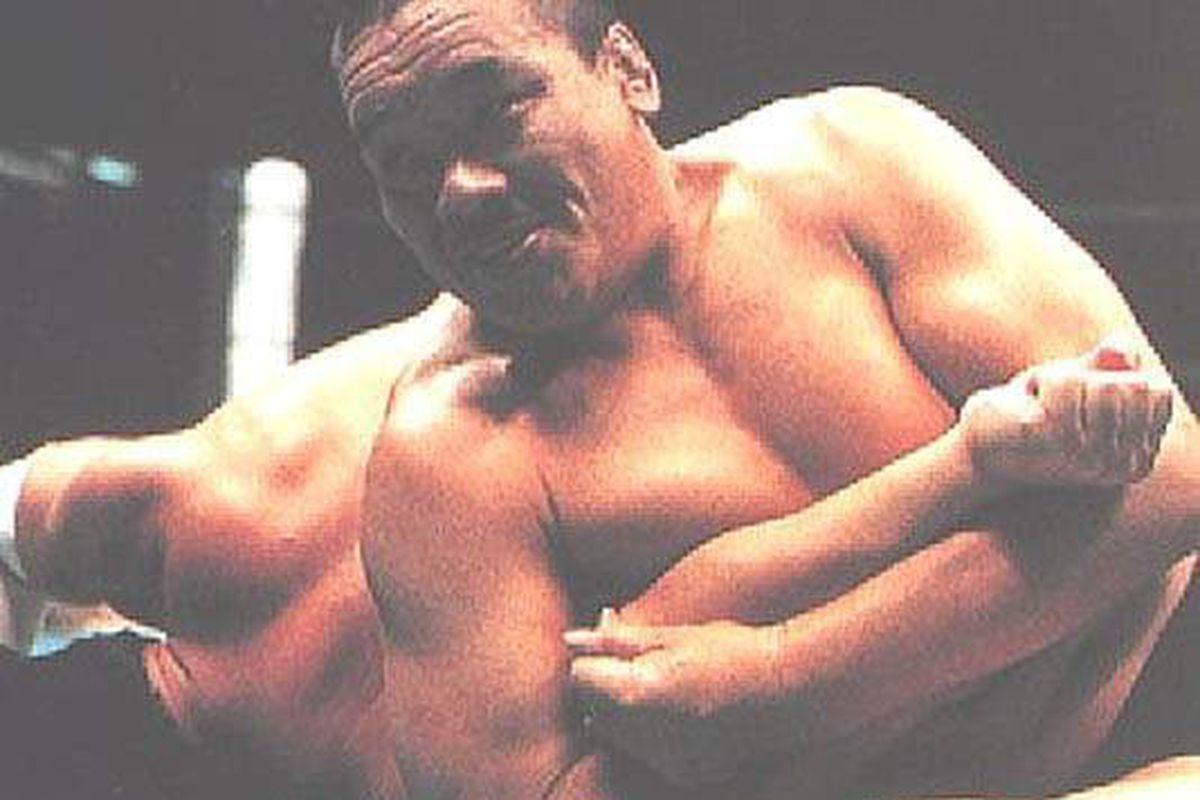 Yoshiaki Fujiwara, applying his signature Fujiwara armbar on a compliant opponent.