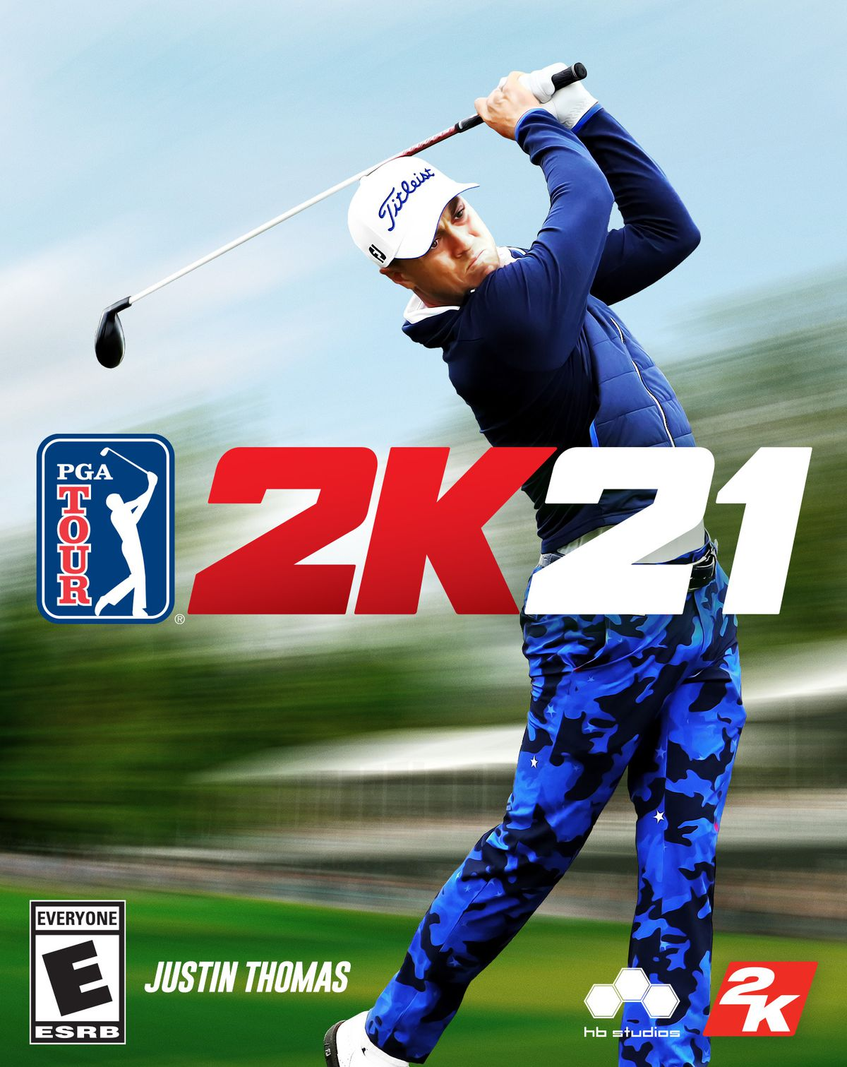 PGA Tour 2K21 box art with Justin Thomas, wearing blue/black camo pants and a blue padded vest, completing a swing