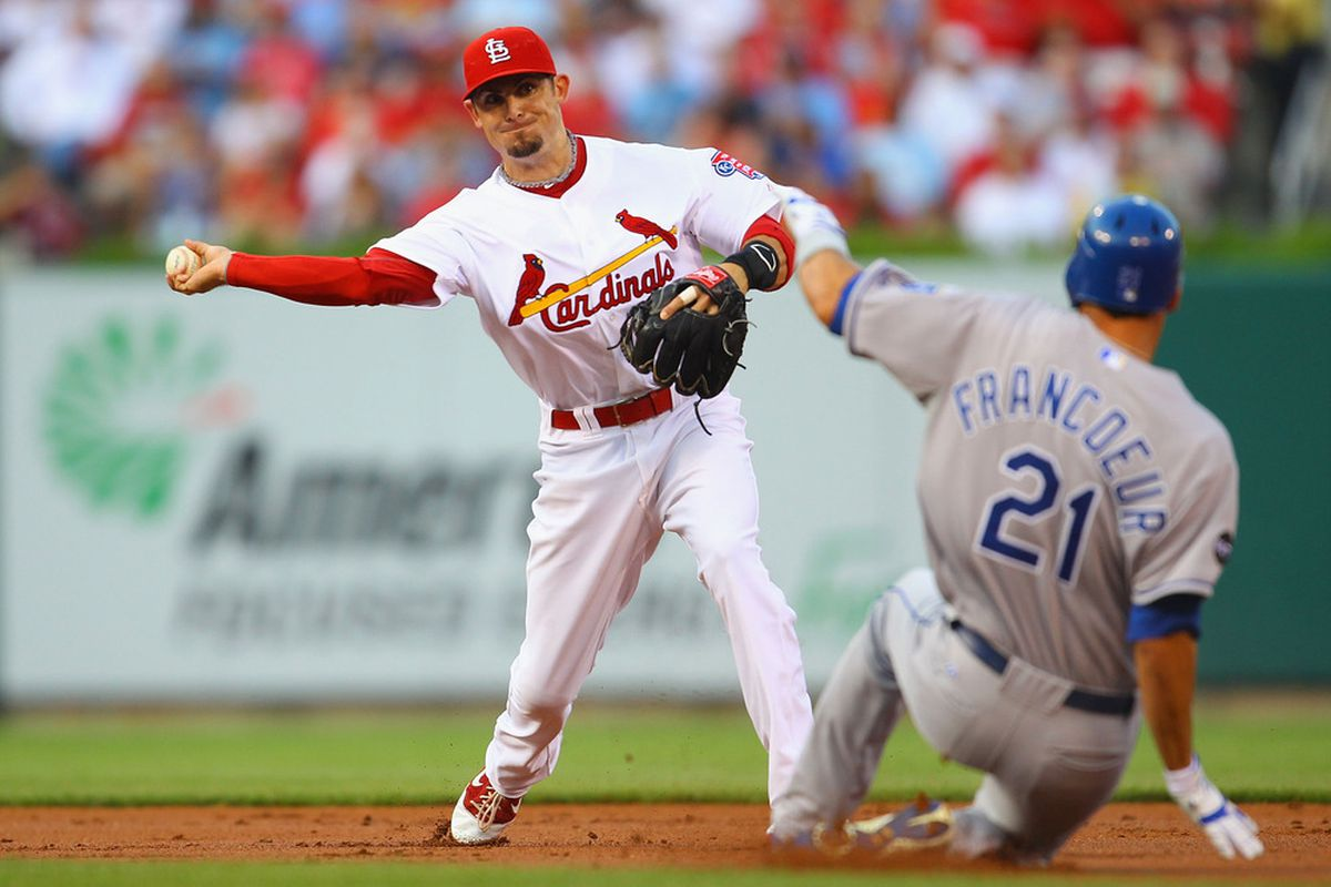 ST. LOUIS, MO - JUNE 17: Tyler Greene #27 of the St. Louis Cardinals turns a double play against Jeff Francoeur #21 of the Kansas City Royals at Busch Stadium on June 17, 2011 in St. Louis, Missouri.  (Photo by Dilip Vishwanat/Getty Images)