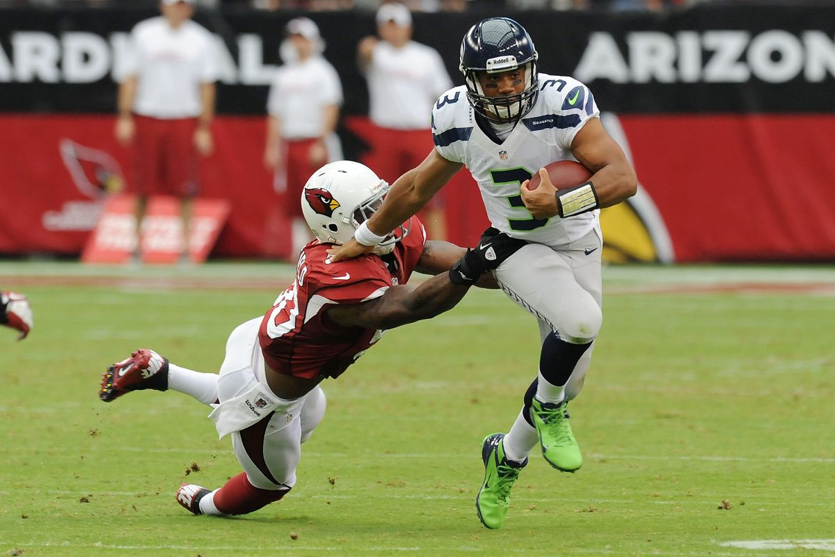 GLENDALE, AZ - SEPTEMBER 09:  Russell Wilson #3 of the Seattle Seahawks avoids a tackle by O'Brien Schofield #50 of the Arizona Cardinals at University of Phoenix Stadium on September 9, 2012 in Glendale, Arizona.  (Photo by Norm Hall/Getty Images)