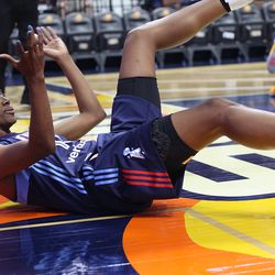 Atlanta Dream's Tiffany Hayes (15) looks at the ref for a foul call.