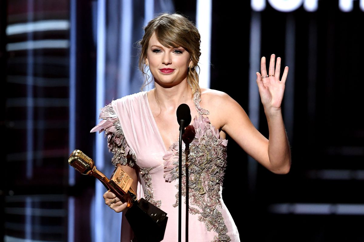Taylor Swift on stage, waving