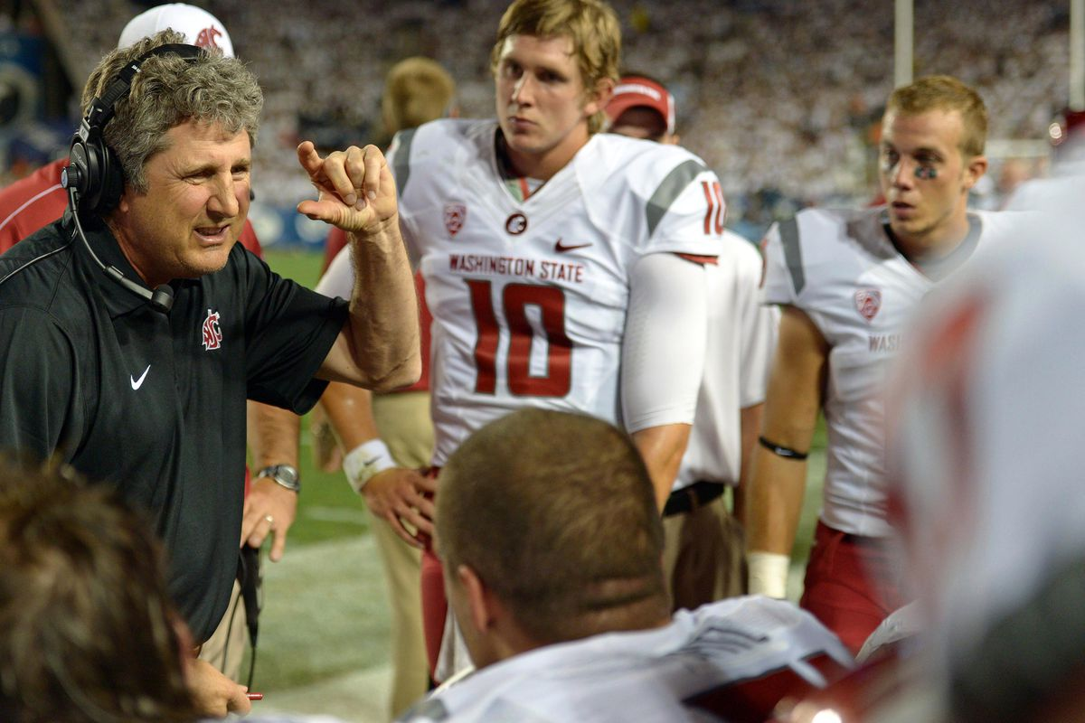 Aug 30, 2012; Provo, UT, USA; Washington State Cougars head coach Mike Leach (left) talks to his players during the second quarter against the Brigham Young Cougars at Lavell Edwards Stadium. Mandatory Credit: Jake Roth-US PRESSWIRE