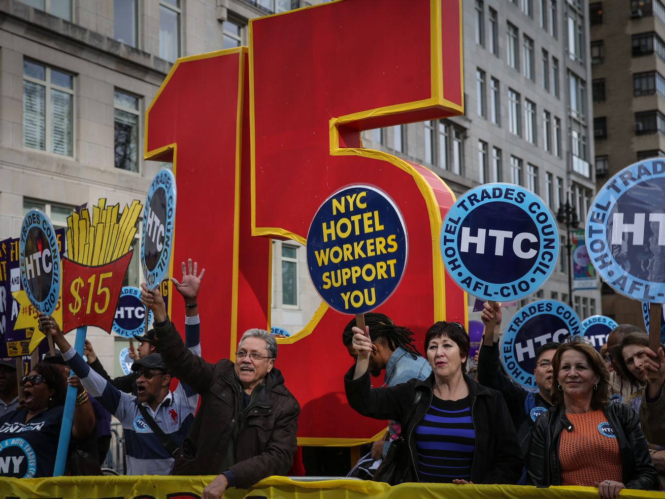 Workers rally for a $15 minimum wage at Colombus Square in New York City on April 15, 2015.
