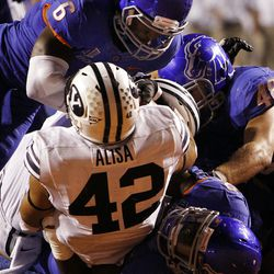Michael Alisa of the Brigham Young Cougars is tackled near his own goal line during NCAA football in Boise, Thursday, Sept. 20, 2012.