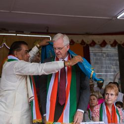 Elder D. Todd Christofferson, a member of the Quorum of Twelve Apostles for The Church of Jesus Christ of Latter-day Saints, center, is facilitated by Prof. Dr. Vishwanath D. Karad, president, World Peace Centre (Alandi), MAEER's MIT World Peace University, during the 71st Independence Day celebrations at the MIT World Peace University in Pune, Maharashtra, India, on August 15, 2017.
