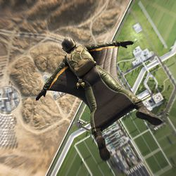 A player dives in a wingsuit over Egypt, in Battlefield 2042's Renewal map