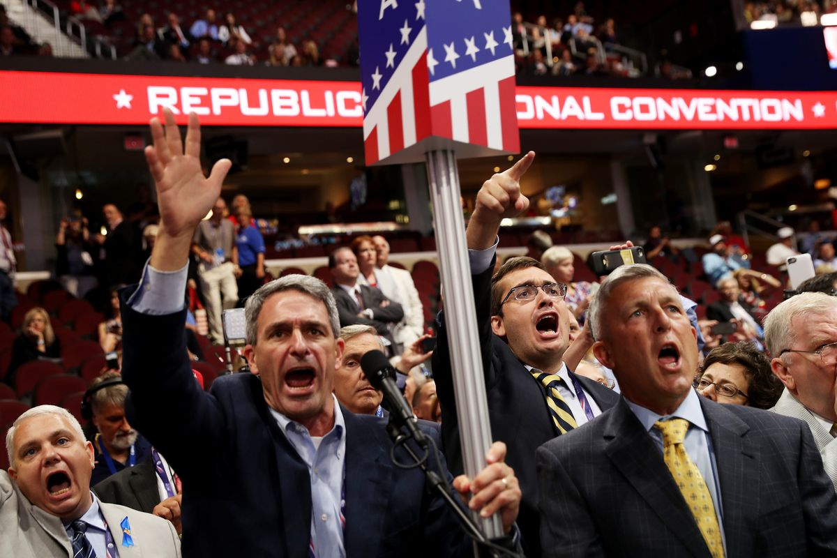 Former Virginia Attorney General Ken Cuccinelli, along with other delegates from Virginia, chant for a roll call vote on the first day of the Republican National Convention on July 18, 2016.