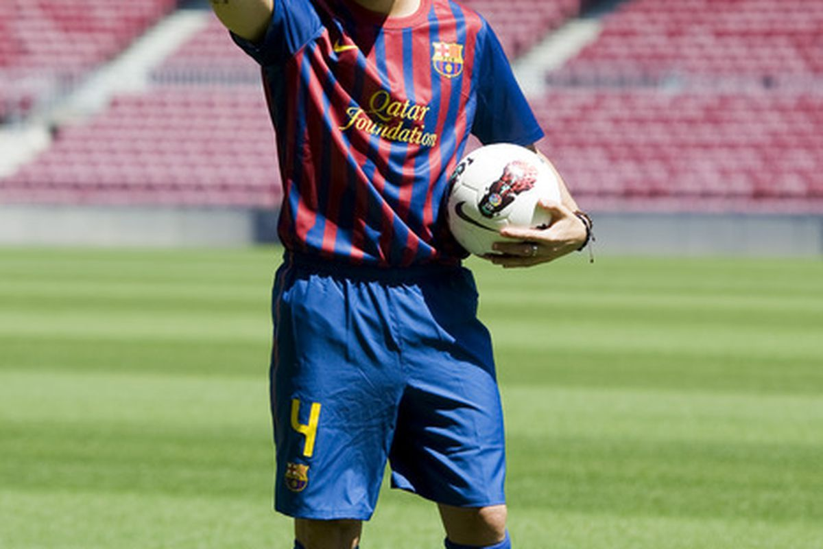 BARCELONA, SPAIN - AUGUST 15:  Cesc Fabregas poses for the photographers during his presentation as the new signing for FC Barcelona at Camp Nou sports complex on August 15, 2011 in Barcelona, Spain.  (Photo by David Ramos/Getty Images)