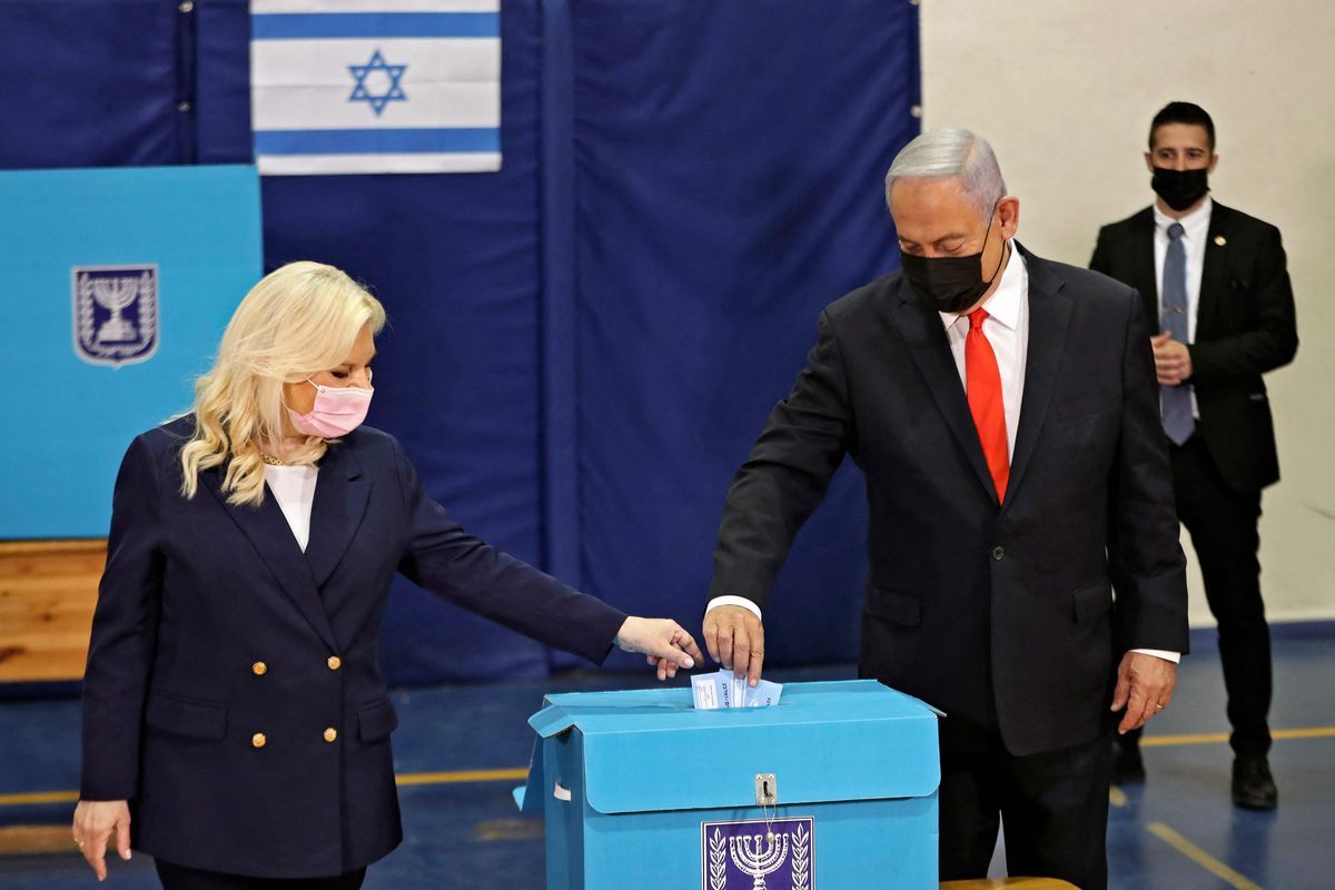 Israeli Prime Minister Benjamin Netanyahu and his wife Sara cast their ballots at a polling station in Jerusalem on March 23, 2021 in the fourth national election in two years.