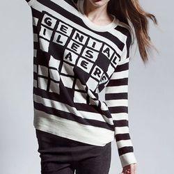 "<b>Devastee</b> Crossword Sweater, <a href=""http://shop.dagnyandbarstow.com/collections/knitwear/products/crossword-sweater"">$355</a> at Dagny+Barstow"