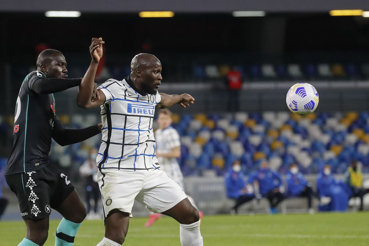 Inter Milan's Belgian forward Romelu Lukaku fights for the...