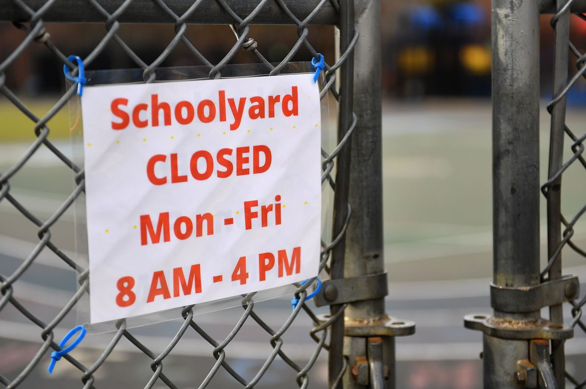 A sign for closed schoolyard outside a public school in New York City on November 19, 2020.