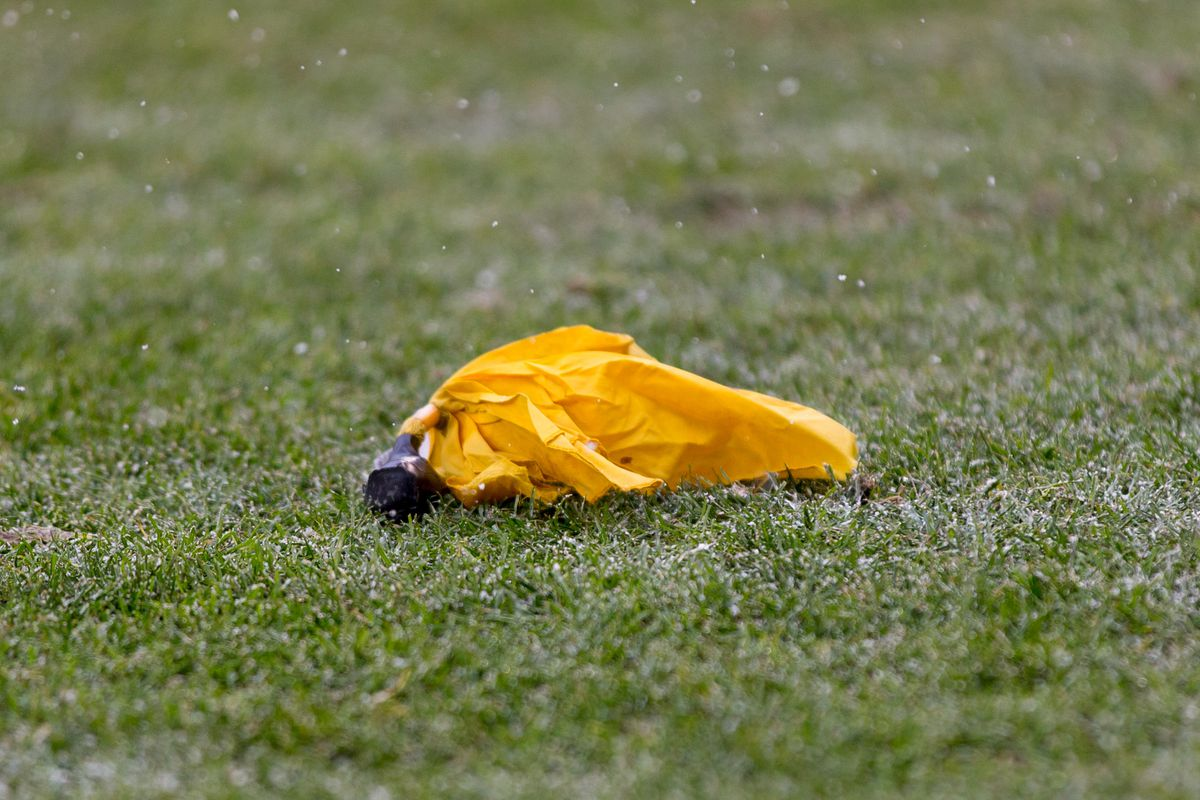 A penalty flag sits on the field during the game between the Houston Texans and Green Bay Packers at Lambeau Field.