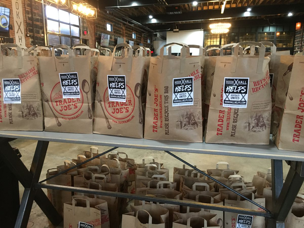 Paper grocery bags lined up on a counter