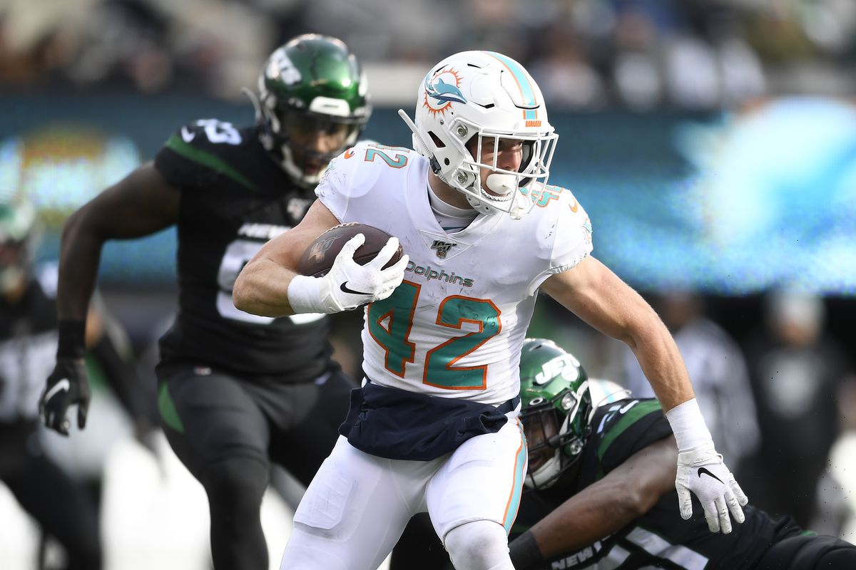 Patrick Laird of the Miami Dolphins carries the ball during the first half of the game against the New York Jets at MetLife Stadium on December 08, 2019 in East Rutherford, New Jersey.