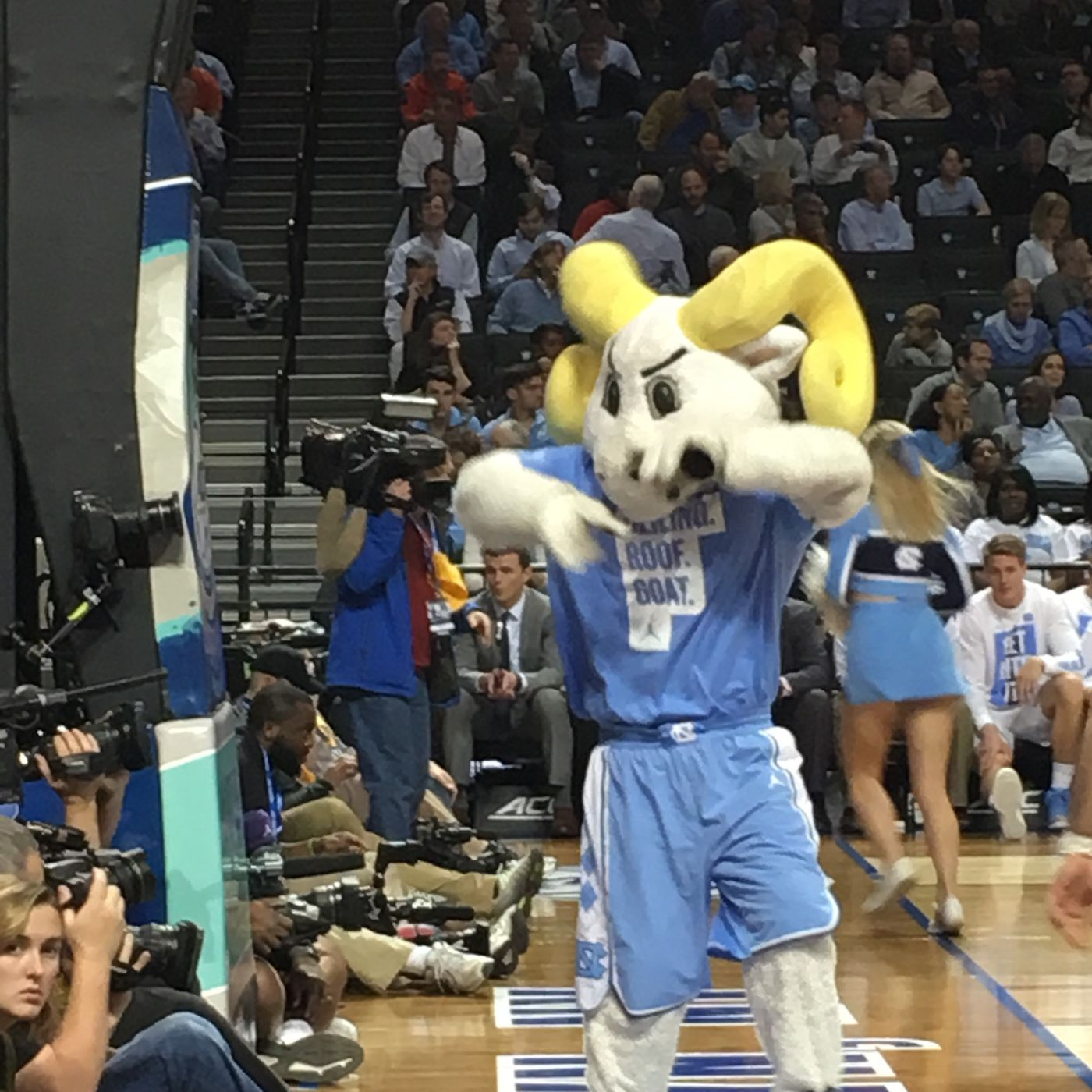 0cd4770cd1fb26 UNC s band and mascot are wearing shirts that say  CEILING. ROOF. GOAT.