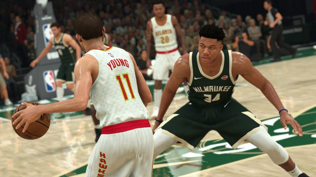 Trae Young sizes up defender Giannis Antetokounmpo at midcourt in NBA 2K21