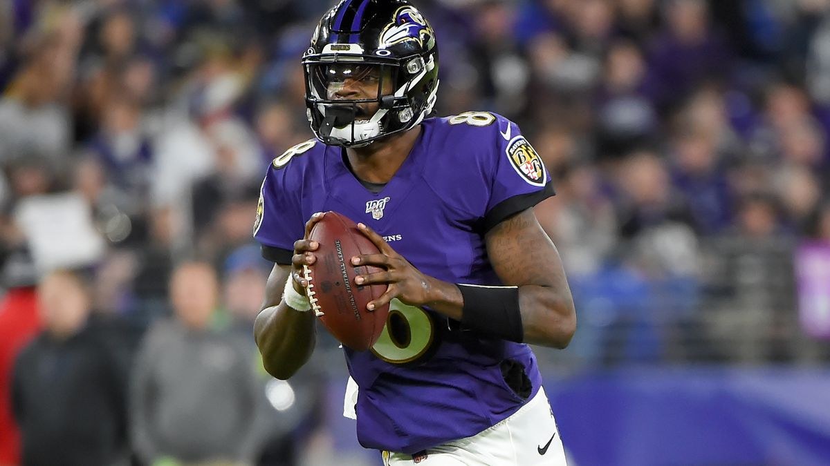 Lamar Jackson #8 of the Baltimore Ravens looks to pass against the Tennessee Titans during the AFC Divisional Playoff game at M&T Bank Stadium on January 11, 2020 in Baltimore, Maryland.