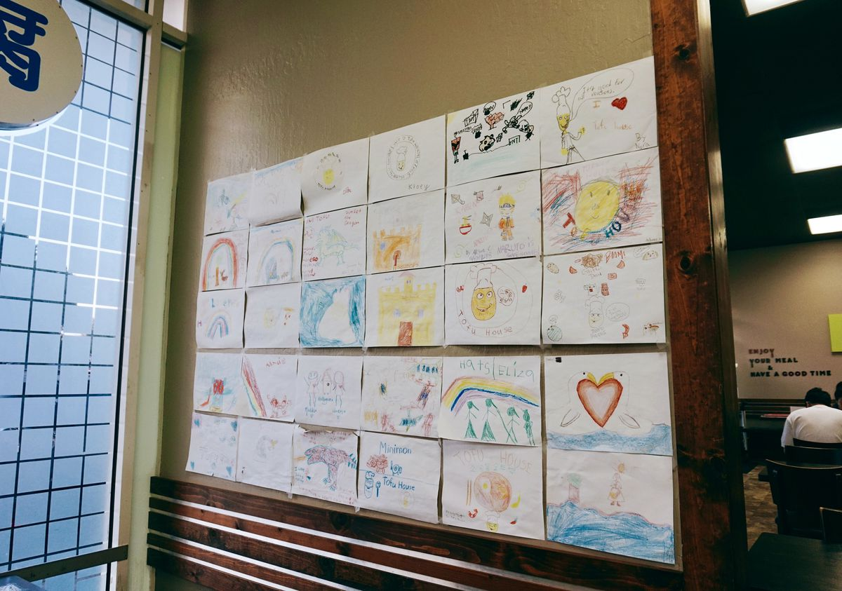 The walls at SGD Tofu House are plastered with colorful drawings and messages of support from the restaurant's young visitors, making it clear the restaurant is more than just a place to eat.